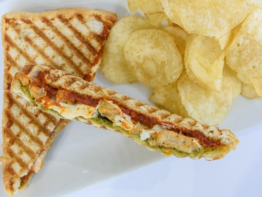 The grilled chicken pesto panini at Scarlet's Bakery,