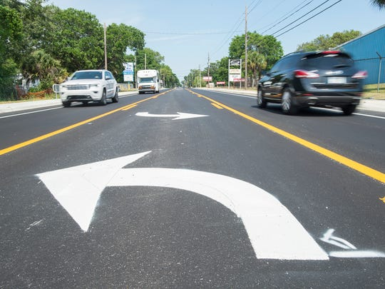 Traffic flows unimpeded by construction along East Olive Road in Pensacola in May 2018 after Escambia County finished the first phase of the road widening project.