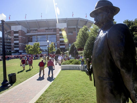 The statue of Bear Bryant stands in front of Bryant-Denny Stadium in Tuscaloosa on Saturday, October 22, 2016.