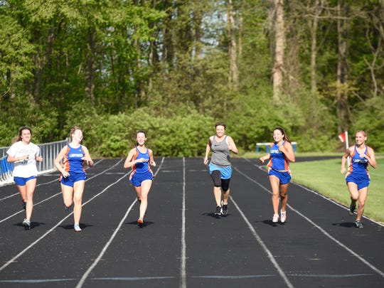 The 200 meter run during a special track meet that invited alumnae back to the track one last time before the school closes at the end of the school year.
