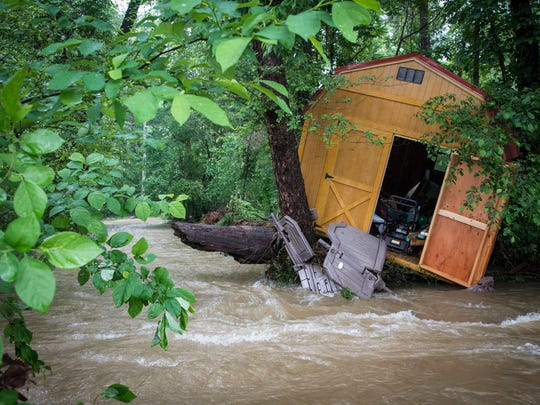 Overnight rains Tuesday caused a garden shed to capsize into Flat Creek behind Black Mountain Primary School.