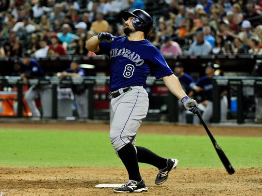Aug 8, 2014; Phoenix, AZ, USA; Colorado Rockies catcher Michael McKenry (8) hits a solo home run during the fifth inning against the Arizona Diamondbacks at Chase Field. Mandatory Credit: Matt Kartozian-USA TODAY Sports