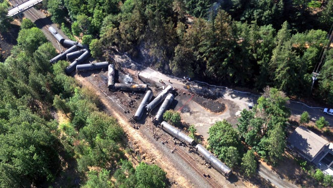 This June 4, 2016, file aerial photo shows scattered and burned oil tank cars after a train derailed and burned near Mosier.