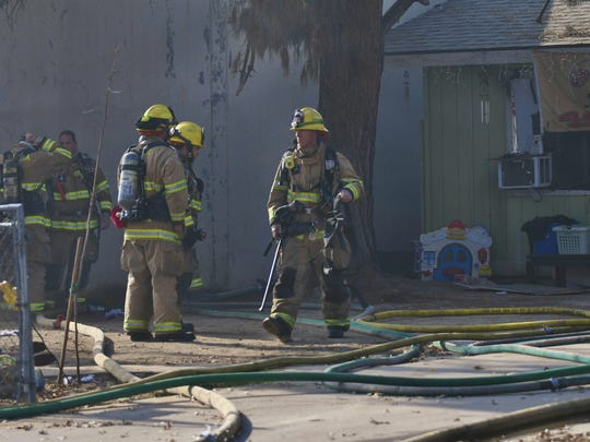 More than 20 firefighters were called to a house fire at the corner of Houston Avenue and Court Street Friday afternoon.