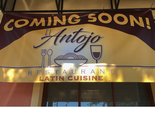 A banner announcing the future El Antojo went on display Saturday outside the former Continental Flambé.