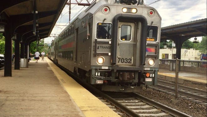 A train pulls into the Morristown Station at 8 a.m. Monday.