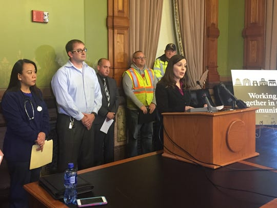 Kelly McMahon, a kindergarten teacher at Hoover Elementary School in Cedar Rapids, speaks at a news conference Thursday at the Iowa Capitol in opposition to changes in public employees' collective bargaining laws.