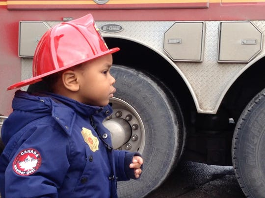 Xavier Smith of Plattsburgh, N.Y., checks out a Burlington Fire Department truck at the UVM Children's Hospital Wednesday.
