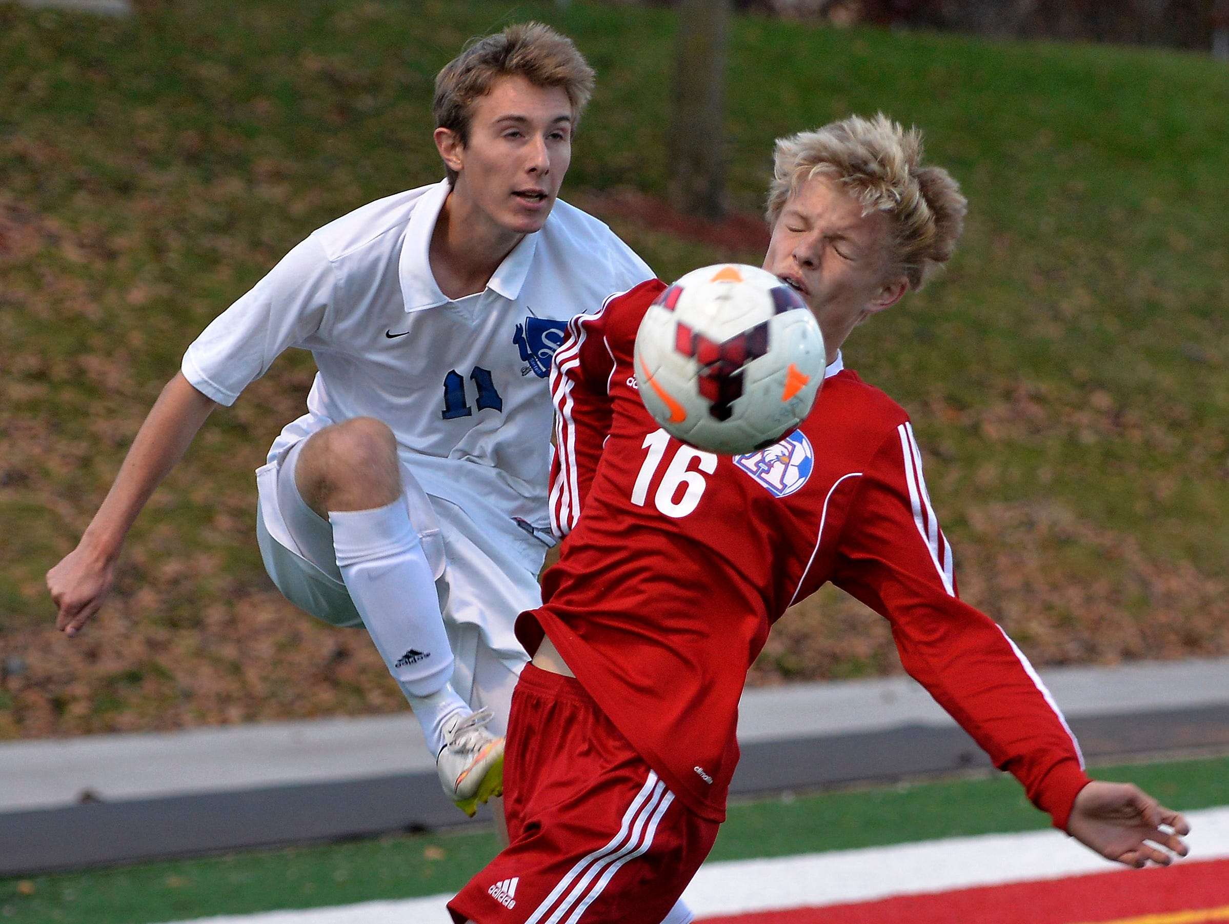 Sartell's Riley Sanderson (11) kicks the ball into the face of St. Cloud Apollo's Logan Lommel (16) in the first half of their Sect. 8A championship game Thursday, Oct. 22 at Husky Stadium.