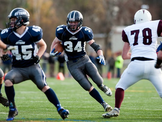 Otter Valley's Carson Leary (34) runs with the ball in last year's Division III high school football championship game.