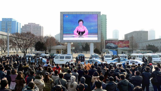 A photo released by North Korea's official Korean Central News Agency on Jan. 6, 2016, shows North Korean people in Pyongyang celebrating the success of the first hydrogen bomb test the government said it conducted.