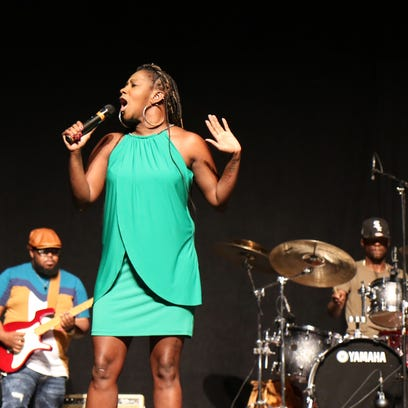 Le'Andria Johnson sings during a gospel concert Sunday