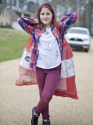 Becca Blair, 9, prepares to do her neighborhood recycle pick up on Monday afternoon. She started a curbside recycling program a year ago in her Brandon neighborhood as part of her home-school math requirements and in partnership with Keep the Rez Beautiful.