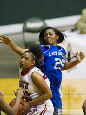North Caddo's Destiny Rice eyes the goal post against Red River's Zlaya Drakes in the Allstate Sugar Bowl/LHSAA GirlsÕ Top 28 Basketball Tournament in Hammond March 3, 2016.