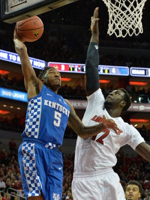 Kentucky's Malik Monk (5) goes in for a basket against the defense of Louisville's Mangok Mathiang (12) during the first half Dec. 21, 2016.