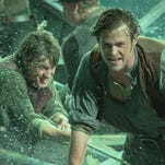 """Chris Hemsworth, front, goes on a doomed whaling adventure in Ron Howard's """"In the Heart of the Sea."""""""