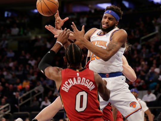 New York Knicks' Mitchell Robinson tries to hold onto the ball during the second half of the NBA basketball game against the Miami Heat, Sunday, Jan. 27, 2019, in New York. (AP Photo/Seth Wenig)