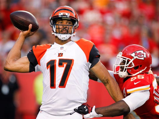 Cincinnati Bengals quarterback Jason Campbell (17) passes the ball as he Kansas City Chiefs linebacker Dee Ford (55) moved in during the first half of an NFL preseason football game Thursday, Aug. 7, 2014, in Kansas City, Mo. (AP Photo/Colin E. Braley)