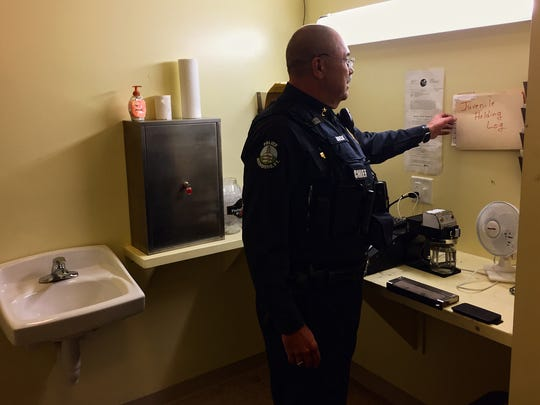 Richmond Police Chief Alan Buck gives the Free Press a tour of the department's holding cell, which also houses their Breathalyzer and fingerprinting equipment. Buck said one arrested subject managed to kick and break some of the equipment while handcuffed to the bench on the opposite wall.