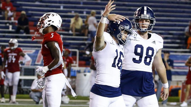 Georgia Southern's Tyler Bass (16) celebrates with Anthony Beck II (98) after kicking a field goal to defeat South Alabama 20-17 in the second overtime of a game Oct. 3, 2019, in Mobile, Ala. The Eagles, whose spring practices were erased by the coronavirus pandemic, are hoping to get back to playing games in the fall along with the other Sun Belt Conference schools.