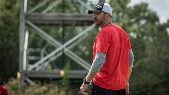 Ball State University's Head Coach Mike Neu  watches the team run drill Aug. 2 at the practice fields directly next to Scheumann Stadium. The practice was the first full team practice of the 2017 season.