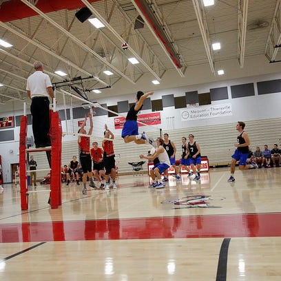 Germantown's Byce Thomas leaps up to make contact with the ball during the second set of his varsity teams match against Homestead in Homestead High School Wednesday, Oct. 19, 2016, in Mequon, Wisconsin.