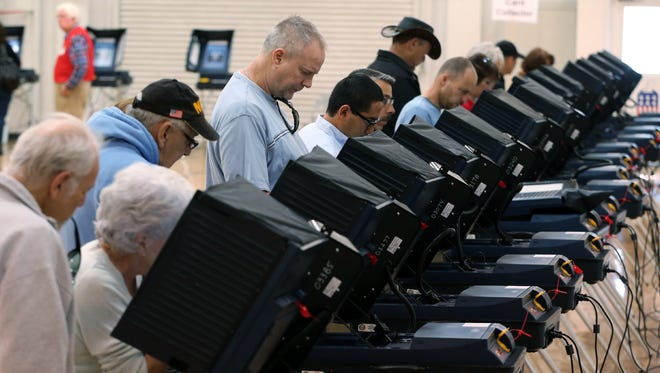 People cast their ballots in Carson City, Nev., on Nov. 4, 2014.