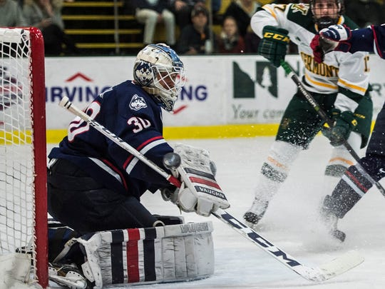 UConn goalie Adam Huska deflects a shot wide during their Hockey East men's hockey match up against UVM at Gutterson Fieldhouse Tuesday night, Nov. 21, 2017.