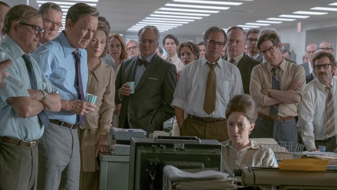 "Howard Simons (David Cross), Frederick ""Fritz"" Beebe (Tracy Letts), Ben Bradlee (Tom Hanks), Kay Graham (Meryl Streep), Arthur Parsons (Bradley Whitford), Chalmers Roberts (Philip Casnoff), Paul Ignatius (Brent Langdon), Meg Greenfield (Carrie Coon, seated) and other members of The Washington Post in ""The Post."""