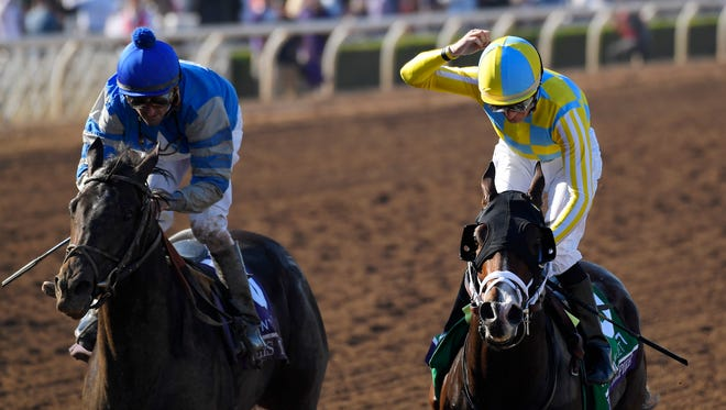 Julien Leparoux, right, celebrates after Classic Empire won the Breeders' Cup Juvenile horse race, with Not This time, left, with Robby Albarado, in second at Santa Anita, Saturday, Nov. 5, 2016, in Arcadia, Calif. (AP Photo/Mark J. Terrill)