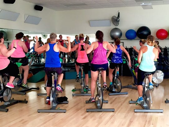 A group fitness class, such as RPM at the Greenheck