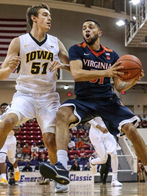 Virginia guard Darius Thompson (51) drives to the basket