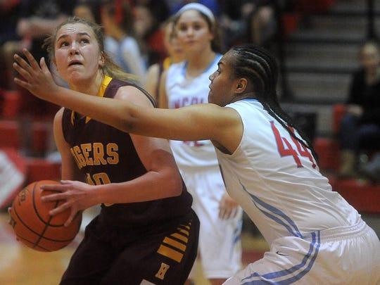 Harrisburg's Jeniah Ugofsky looks toward the basket