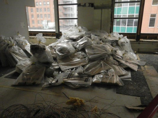 Piles of asbestos at Younkers