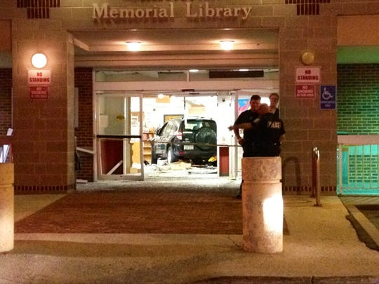 A sport-utility vehicle sits inside the Finkelstein Memorial Library in Spring Valley after pinning a 15-year-old girl and striking four others on Tuesday night, May 27, 2014.