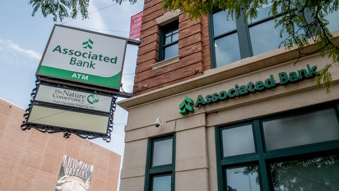 Some branches of the Associated Bank like this one at 240 SW Jefferson Avenue in Downtown Peoria, will soon be disappearing from the Peoria area. The Wisconsin-based bank is selling some if its local branches to Hometown Community Banks, a division of Morton Community Bank. Four Peoria-area branches will close in December.