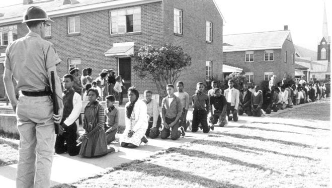 Students that marched for voting rights are arrested in early 1965.