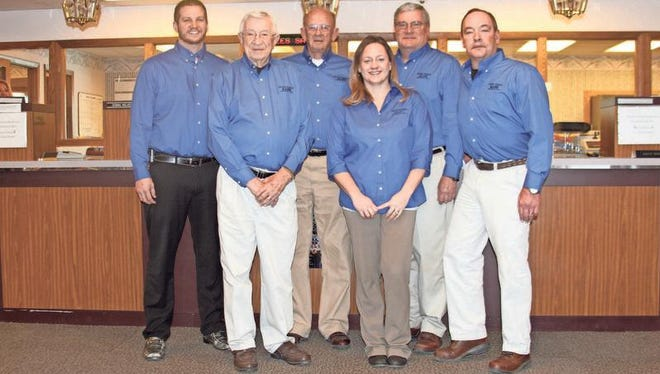 Three generations still work at Peoples Savings Bank, including, from left, Curtis Bolen, Dick Arendt, Bill Bolen, Heather Snook, David Arendt and Mike Arendt.