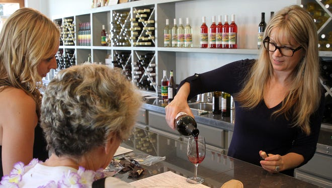 Laurin Dorman, a sommelier at Old York Cellars, pours a glass of wine for a tour in the winery's tasting room. On July 14, Old York once again will present its Jersey Fest, featuring its What Exiit wines, food trucks, live music and screenings of Garden State Film Festival winners.