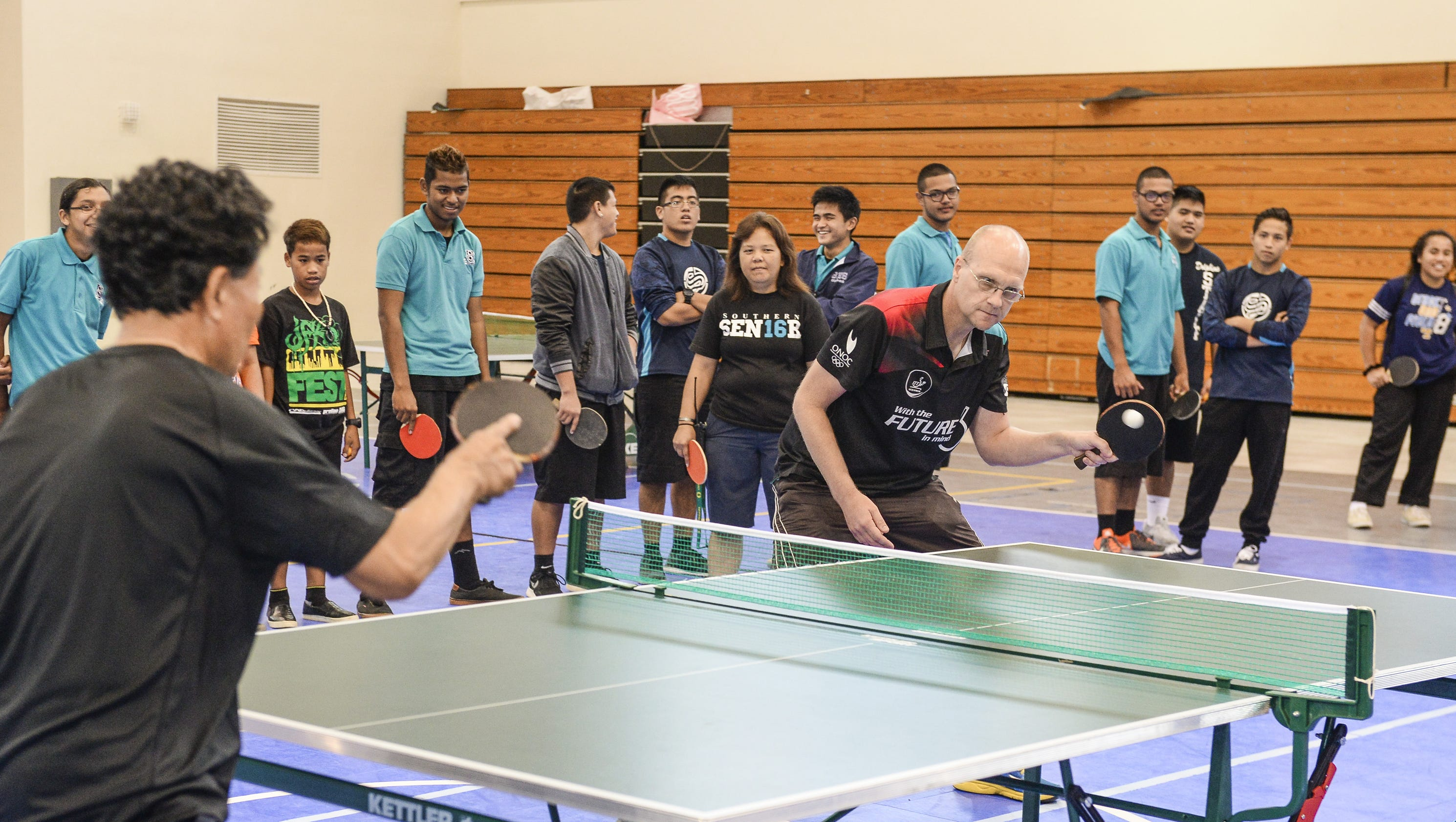Table tennis olympian shows sport to guam students for Table tennis 6 0