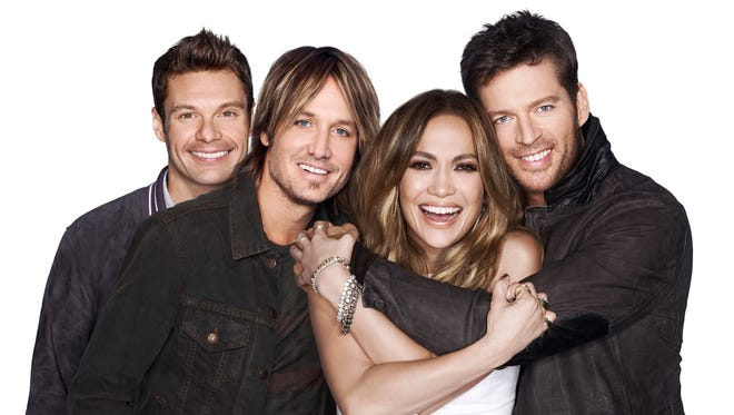 Host Ryan Seacrest, left, and judges Keith Urban, Jennifer Lopez and Harry Connick Jr.