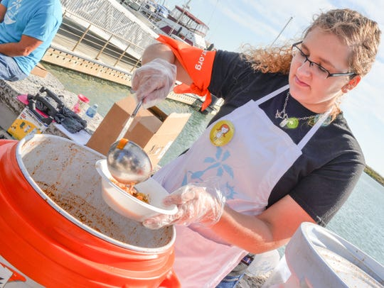 Volunteer Emily Phillips serves soup at the 11th Annual
