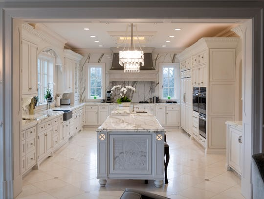 The Bellamont's kitchen features custom cabinetry, marble countertops, hand carved stone sinks, and commercial grade appliances.