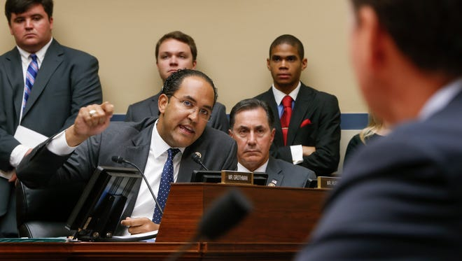 House Oversight and Government Reform Committee member U.S. Rep. Will Hurd, R-Texas, joined at right by U.S. Rep. Gary Palmer, R-Ala., questions FBI Director James Comey as he testifies Thursday on Capitol Hill in Washington, D.C., before the committee's hearing to explain his agency's recommendation to not prosecute Democratic presidential candidate Hillary Clinton over her private email setup during her time as secretary of state.