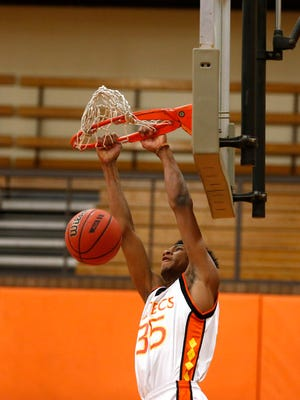 Marvin Bagley III, Corona del Sol basketball player, dunks the ball while shooting around with his teammates at the school's gym in Tempe on April 16, 2015.