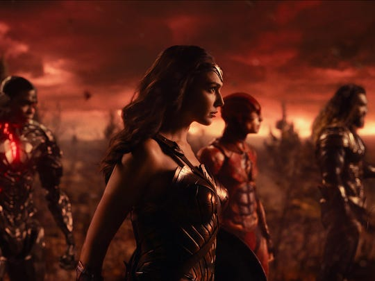 Wonder Woman (Gal Gadot, center) leads superhero newcomers Cyborg (Ray Fisher), The Flash (Ezra Miller) and Aquaman (Jason Momoa) into battle in 'Justice League.'