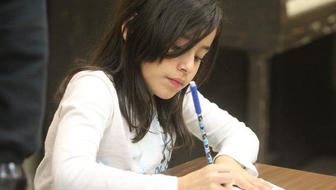 Karen Urrutia, 9, of Nyack works on homework in the after-school program at the Nyack Center in 2012.