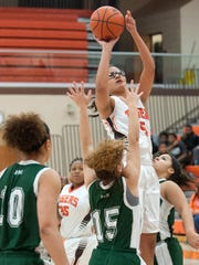Jeryn Reese shoots the ball for Mansfield Senior during the Lady Tygers' game against Madison on Thursday night.