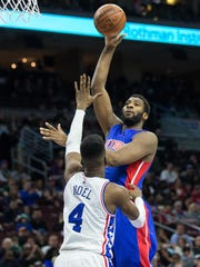 Mar 12, 2016; Philadelphia, PA, USA; Detroit Pistons center Andre Drummond (0) shoots past Philadelphia 76ers forward Nerlens Noel (4) during the second half at Wells Fargo Center. The Detroit Pistons won 125-111. Mandatory Credit: Bill Streicher-USA TODAY Sports