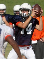 Blackman Nick Effler (14) grabs the snap during practice on the first day to wear football pads for the season, on Monday, July 24, 2017.